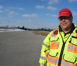 Bob Beilfuss standing by one of his department's completed road projects.