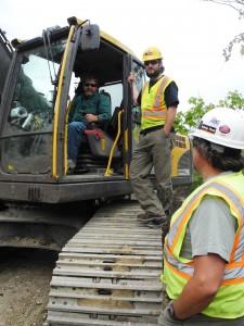 Consulting with Peter Reinhard, excavator operator.